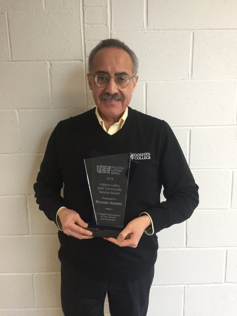 Male professor with an award.