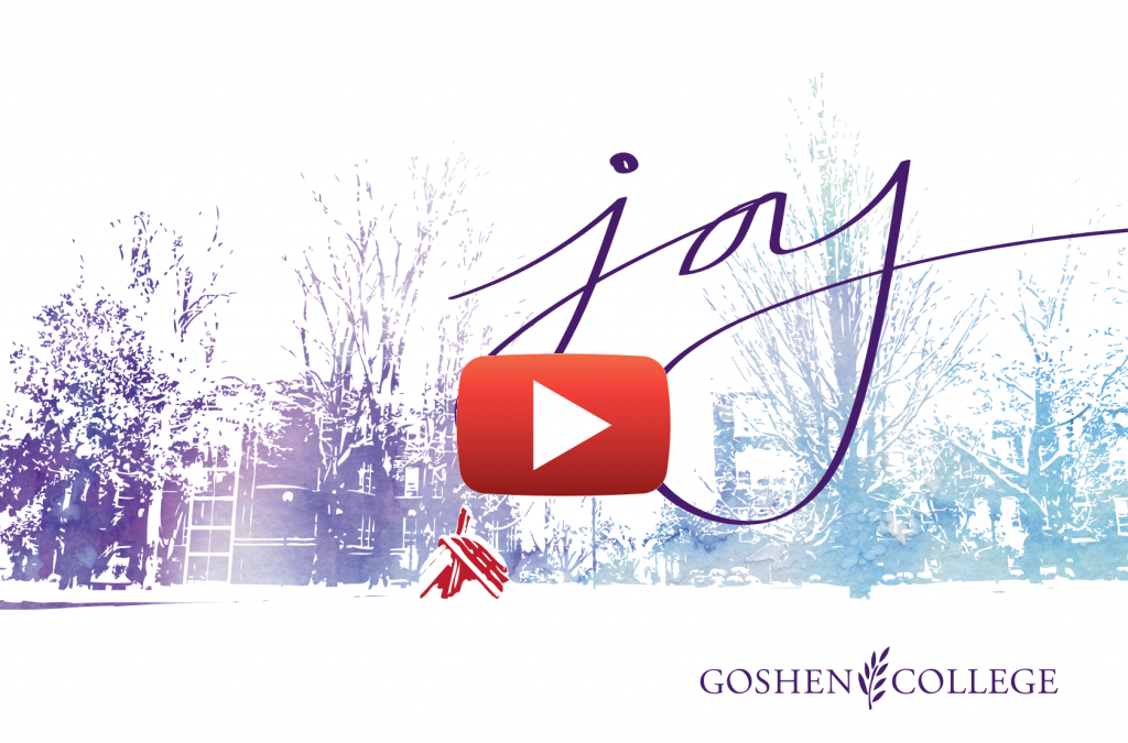 Goshen college with snow on the ground with the word joy