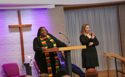 Dr. LaKendra Hardware preaching in the church chapel with ASL interpreter Mia Engle.