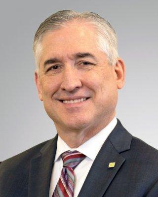 Head shot of Ken Hochstetler in suit and tie.
