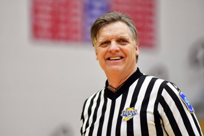 Jay Smith reffing in a gym.