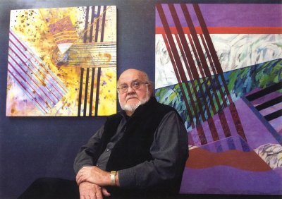 Man sitting in front of two paintings