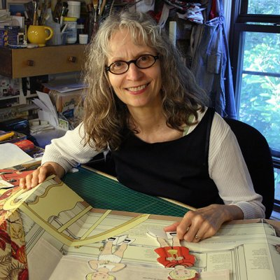 Pan Kratz posing while working on a children's book