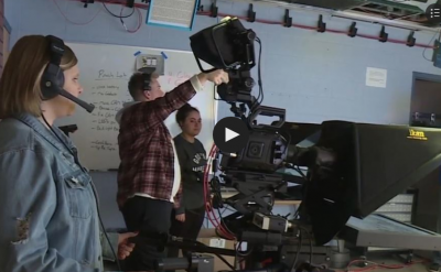 Student use a camera while working with Globe TV