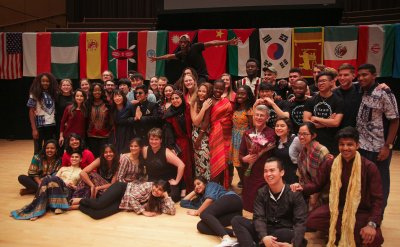 International Students surrounded by flags from many different countries