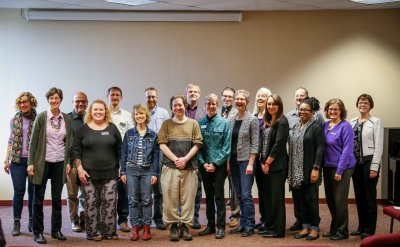 18 faculty members standing together in a group