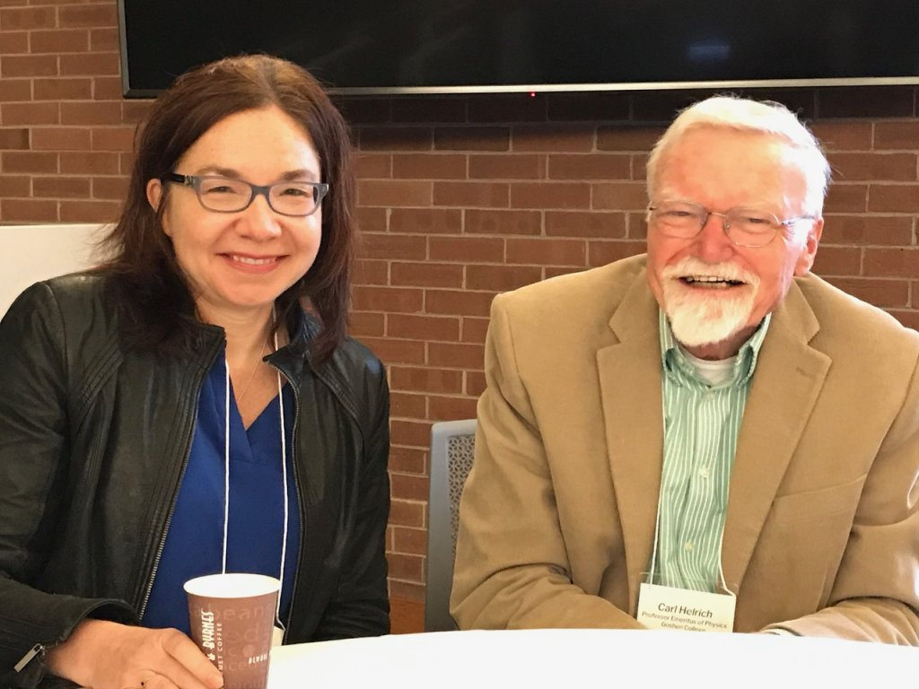 Dr. Katharine Hayhoe and Dr. Carl Helrich sitting at a table at the 2019 Conference on Religion and Science.