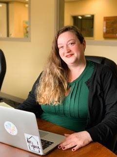Woman sitting in front of a laptop