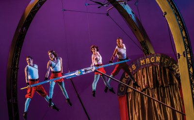Four people performing in the air