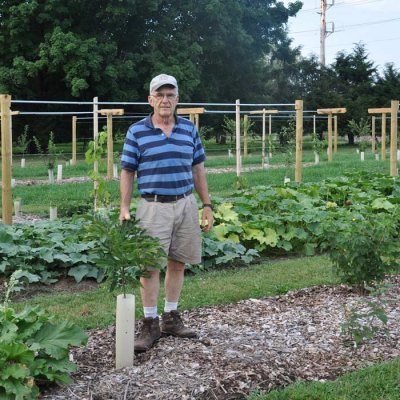 Luke Gascho standing in a garden