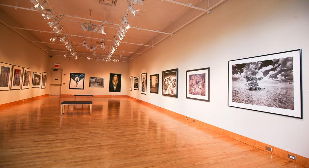 An empty room with paintings on the walls