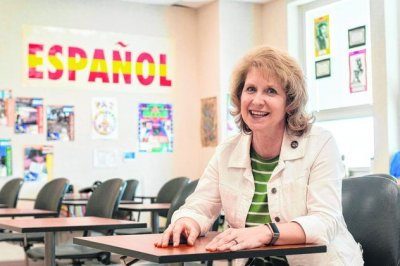Nancy Bailey sitting at a classroom desk