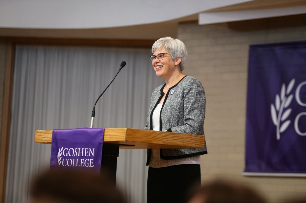 President Rebecca Stoltzfus speaking at a podium