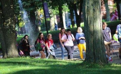 A group of people walking down the sidewalk