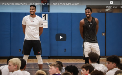 Video of two men standing in gym in front of a group of younger students