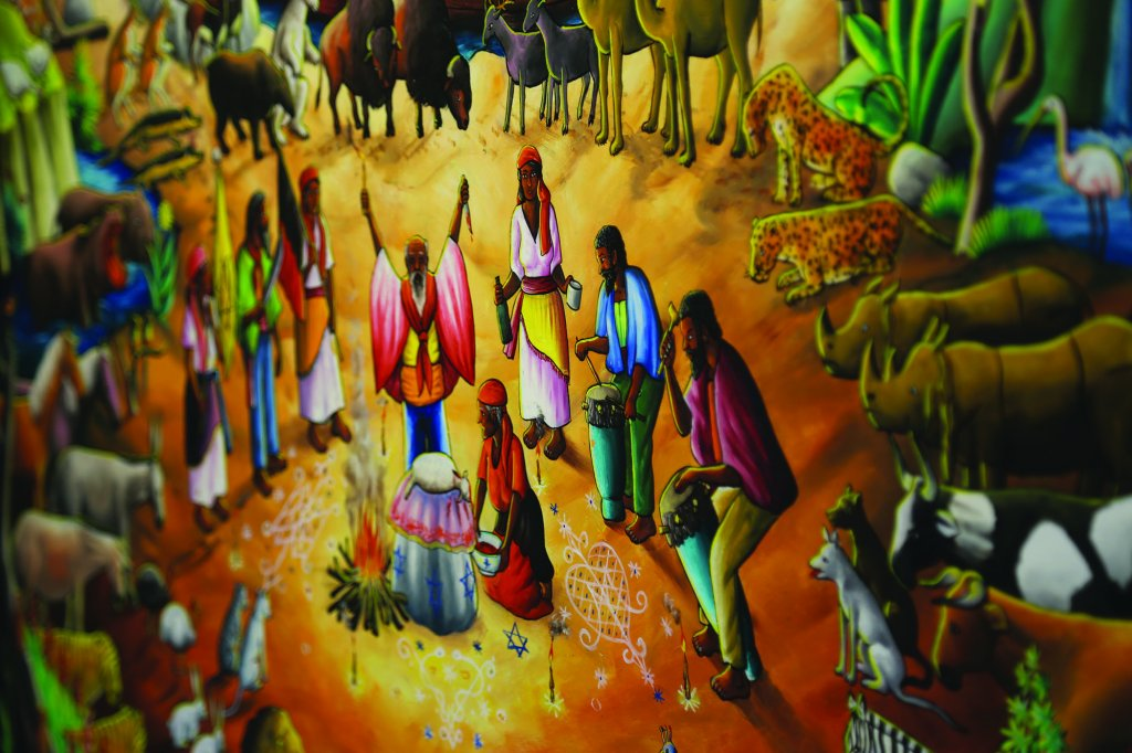 Painting of several people and many animals around a fire