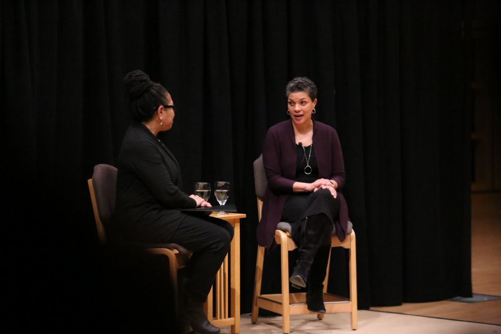 Two women sitting and speaking together