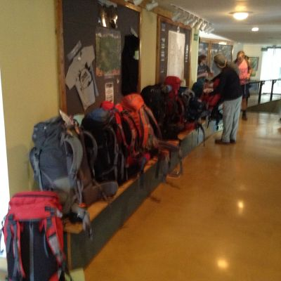 A row of backpacks awaiting their turn to board buses at the start of our trek.