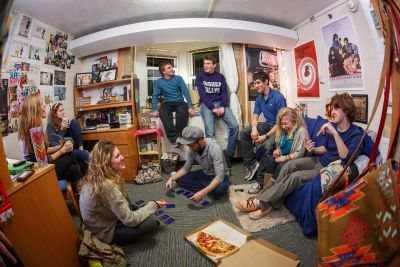A group of students talking and playing games in one of Goshen's traditional residence halls