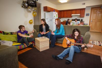 Student apartments available at Goshen College include a kitchen and living area shown here.