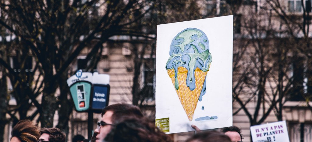 Protest sign of earth melting ice cream cone